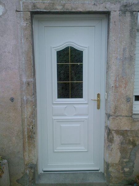 Porte d'entrée PVC en rénovation Petit-bois laiton